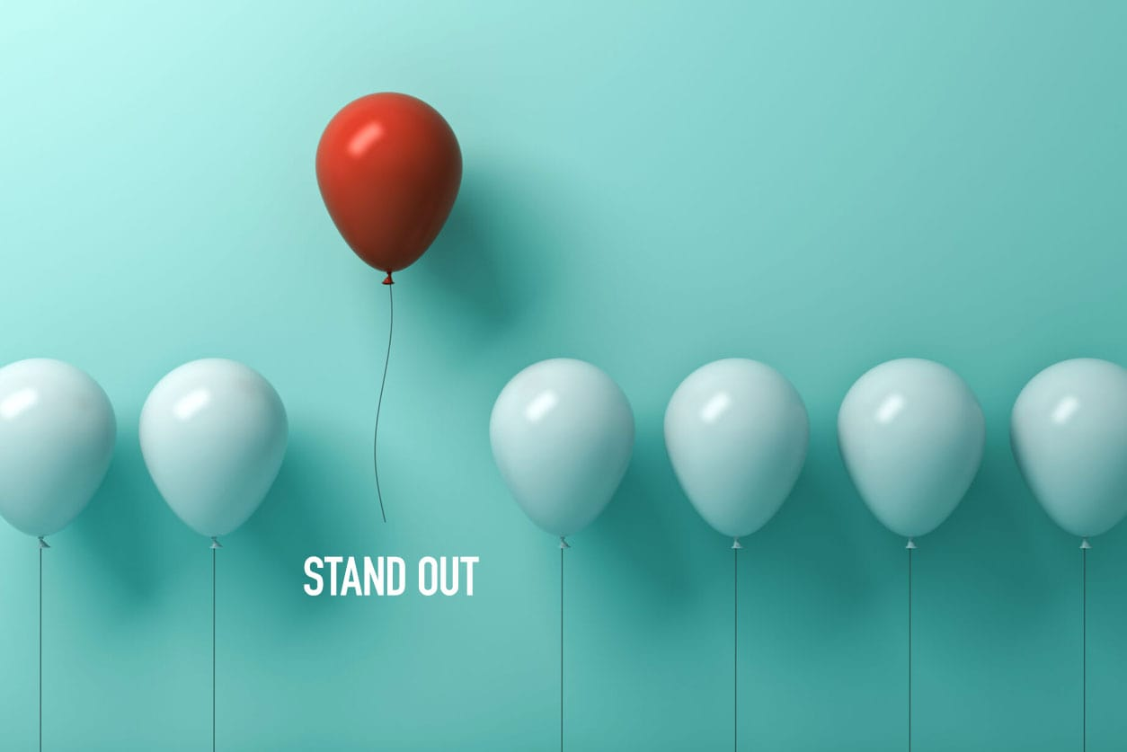 Stand out from the crowd - One red balloon above the rest